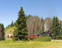 An antique steam train in colorado. A coal-fed train carrying passengers on a scheduled trip through the mountains Royalty Free Stock Image