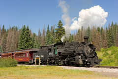 An antique steam train in colorado. A coal-fed train carrying passengers on a scheduled trip through the mountains Stock Photography