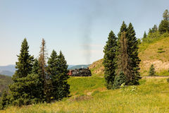 An antique steam train in colorado. A coal-fed train carrying passengers on a scheduled trip through the mountains Stock Photos