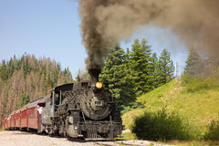 An antique steam train in colorado. A coal-fed train carrying passengers on a scheduled trip through the mountains Royalty Free Stock Photos