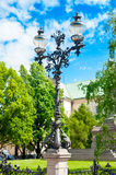 Antique steel lantern near Adam Mickiewicz Monument in Warsaw. Royalty Free Stock Photography