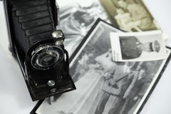 Antique still camera and old photos royalty free stock photos
