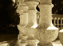 Antique stone baluster in sepia tone. Round structure Stock Photography