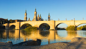 Antique stone bridge in sunny morning. Zaragoza Royalty Free Stock Images