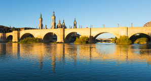 Antique stone bridge in sunny morning. Zaragoza Stock Photo