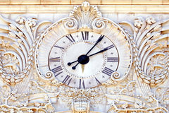 Antique stone clock Royalty Free Stock Photos