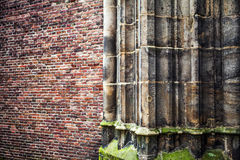 Antique stone column of old church wall as texture close-up. Photo Background Stock Image