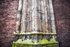 Antique stone column of old church wall as texture close-up. Photo Background Stock Photography
