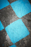 Antique stone floor painted in black and blue mosaic. Background Stock Image