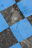 Antique stone floor painted in black and blue mosaic. Background Stock Photo
