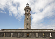 Antique stone lighthouse in Ponta dos Capelinhos. Faial island, Royalty Free Stock Images