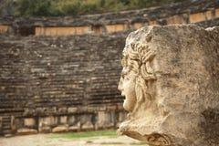 Antique stone mask in Myra. Antique stone mask in  amphitheater Myra Turkey Royalty Free Stock Photos