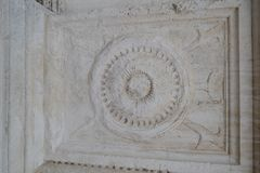 Antique stone relief in gray royalty free stock image