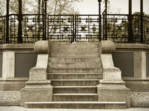 Antique stone stair with metallic fence in sepia tone Royalty Free Stock Photos