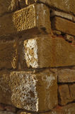 Antique stone wall corner detail. In Algarve, Portugal. Sights of Europe Royalty Free Stock Photos