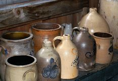 Antique Stoneware Jugs. A collection of antique stoneware jugs and crocks from around New England. (Hadley Farm Museum, Hadley, MA Royalty Free Stock Image