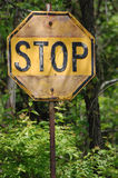 Antique Stop Sign. In the woods Stock Photo