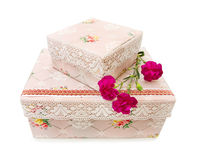 Antique storage boxes with carnations. Old storage boxes decorated with flower pattern and handmade lace. Isolated over white. This image is exclusive to DT stock image