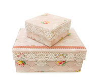 Antique storage boxes with lace. Vintage storage boxes with old handmade lace. Isolated on white background. This image is exclusive to DT Stock Images