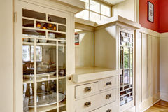 Antique storage combination with glass doors and drawers Royalty Free Stock Image