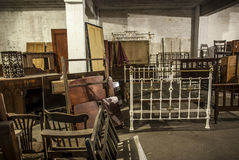 Antique Storage. A selection of antique furniture stored in old warehouse Stock Photography