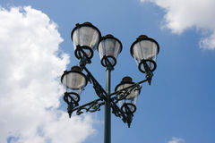 Antique street lamp. Antique metalic street lamp in blue sky background Stock Images
