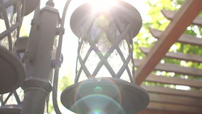 Antique street lamp in a Park with sunlight. Antique street lamp in a Park with sunlight, close-up stock video
