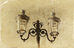 Antique street lamp in vintage style. Old style photo. Stock Image
