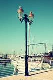 Antique street lamp with yacht.  vintage filtered image Stock Images
