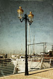 Antique street lamp with yacht and vintage style texture overlaid effect Royalty Free Stock Images