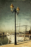 Antique street lamp with yacht and vintage style texture overlaid effect Stock Photos