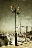 Antique street lamp with yacht and vintage style texture overlaid effect Stock Image