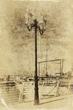 Antique street lamp with yacht and vintage style texture overlaid effect Stock Images