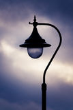 Antique Street Light. Old Lamplight At Dusk With Clouds Stock Images