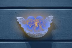 Antique street wall decoration, two little cute marble angels royalty free stock images