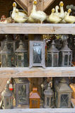 Antique stuff. Some of old style lanterns and ceramic ducks for sale in a flea market stock photography