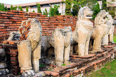 Antique Stupa surrounded by Lion statue cambodia style in Thammikarat Temple Stock Image