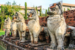Antique Stupa surrounded by Lion statue cambodia style in Thammikarat Temple Stock Images