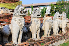 Antique Stupa surrounded by Lion statue cambodia style in Thammikarat Temple Royalty Free Stock Image