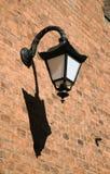 Antique style black iron wall lantern Stock Photos