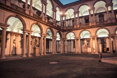 Antique style courtyard in the monuments and columns. Vintage antique style courtyard in the monuments and columns. Background of Brera Gallery, Milan, Italy Royalty Free Stock Photography
