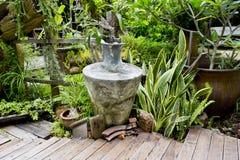 Antique style garden vase in garden Stock Image