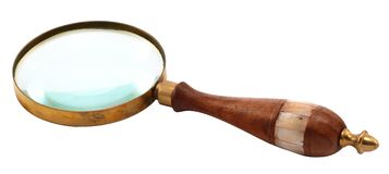 Antique-style magnifying glass Stock Photo