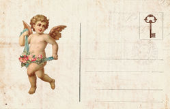 Antique style valentine`s postcard featuring cupid and heart. Antique style victorian valentine`s postcard featuring cupid and heart with blank space for text stock photo