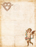 Antique style valentine`s stationary featuring cupid and heart. Antique style victorian valentine`s stationary featuring cupid and heart with blank space for Royalty Free Stock Photos