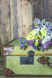Antique suitcase with flowers. Old travel bag with delicate flowers Stock Image