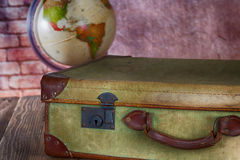 Antique Suitcase with World Ball Royalty Free Stock Photo