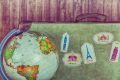 Antique Suitcase with World Ball Stock Image