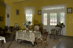 Antique sunroom. Sunroom painted in yellow and decorated in antiques royalty free stock image