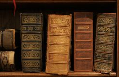 Antique Swedish Bibles on a Shelf royalty free stock photos